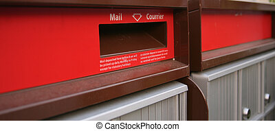 Close up of a mail drop chute on a mailbox