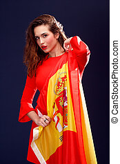 Flag of Spain in hands of beautiful woman. - Flag of Spain...