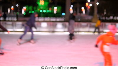 People skate on the rink skating winter. Soft focus...