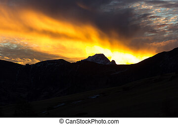 Mountain views of Alpe di Siusi with red sunrise