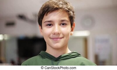 happy smiling preteen boy at school - education, childhood,...
