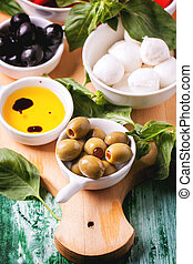 Antipasti - Mixed antipasti olives and mozarella served on...