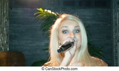 Beautiful young blond woman sings a song. - Beautiful young...