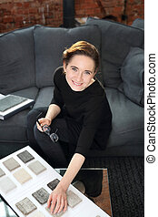 Arranging home shopping coverings - Woman chooses carpet for...