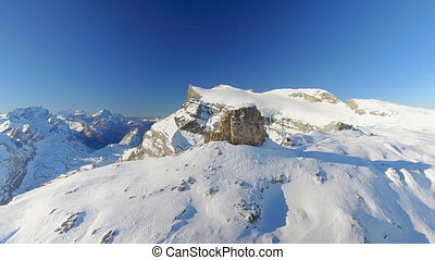 Mountain Peak and Off Piste Ski Slope - An aerial view of an...