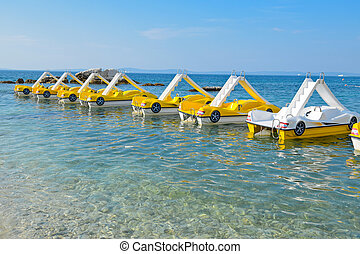 Sea peddle boats on the water surface