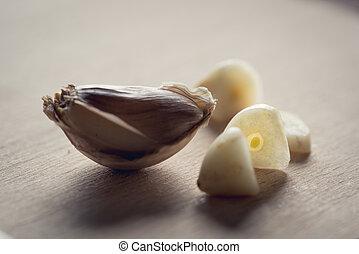 Cuted cloves of garlic - Close-up view at sliced garlic...