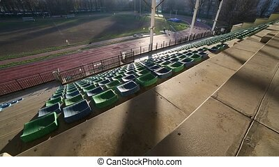 panoramic wide angle from the stands of an athletics and...