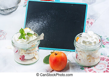 Dessert with merengue and berries - Dessert Eton mess with...