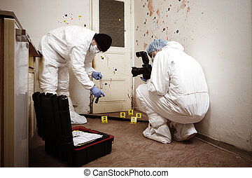 Team of criminologist technicians collecting gun on crime...