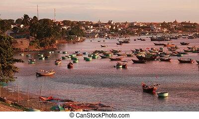 Fishing ships at sunset
