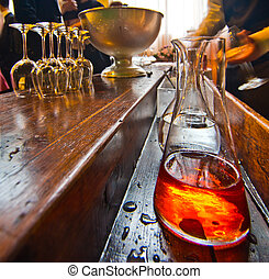 Bar table with bottle of alcoholic liquor - old bar with...