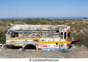 Rusted out old school bus abandoned in the countryside - SAN...