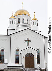 White orthodox church with gold domes,