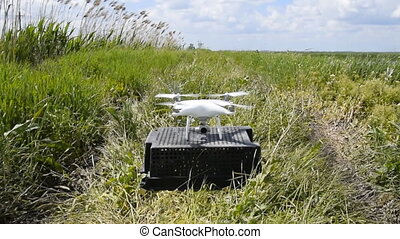 Rise quadrocopters low from the ground in strong winds. Wind...