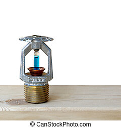 fire sprinkler with fire on wooden background.