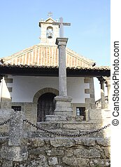 Cross Stone in front a Hermitage in Candelario, a village in...