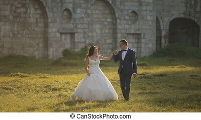 Wedding Couple Walking Before Castle - Walking of young...