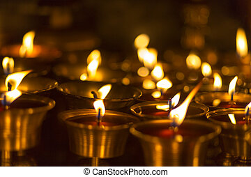 Church candles in Kathmandu - Burning candles in a temple in...