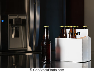 Six pack of brown beer bottles on kitchen counter - Six pack...