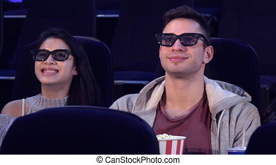 Guy sit between two girls at the movie theater - Handsome...