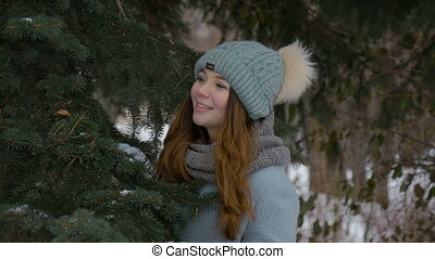 Beautiful young model smiling in winter. Slow motion -...
