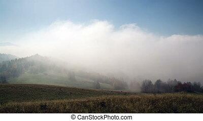 Foggy morning time lapse. Mystic sunrise fog in mountains
