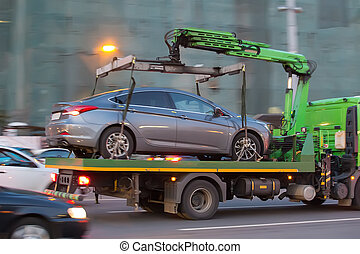 tow truck transports cars