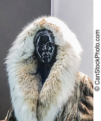 Mannequin woman in a fur coat from arctic fox