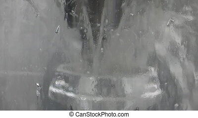 Wet window of CNC milling machine - Blurred view of CNC...