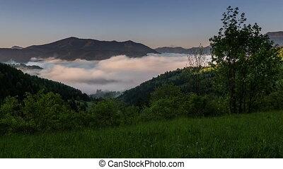 Sunrise morning fog in spring time lapse. Dolly shot over...