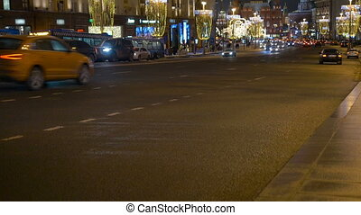 Timelapse. Rapid movement of cars on city streets. In evening time. The city is decorated for Christmas.