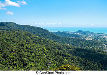 Barron Gorge Canopy and Coral Sea - aerial above rainforest...