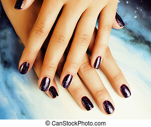 manicure stylish concept: woman fingers with nails purple...
