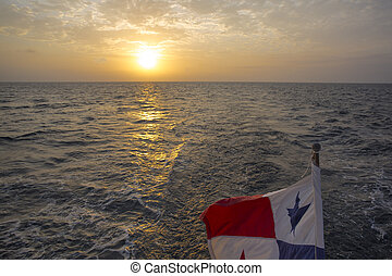Sunset and Panama Flag waving with the sea in The San Blash...