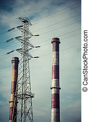 Two industrial chimneys and and a high-voltage electric...