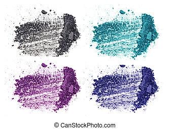 crushed eyeshadow makeup set isolated on white background