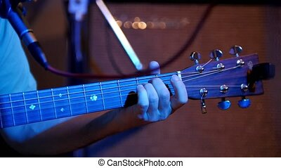 Musician playing acoustic guitar - guitar soundboard,...