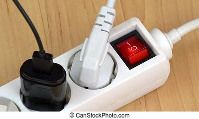 woman finger turn off electricity extension switch with many...