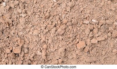 Clay soil surface background - Brown clay soil surface...