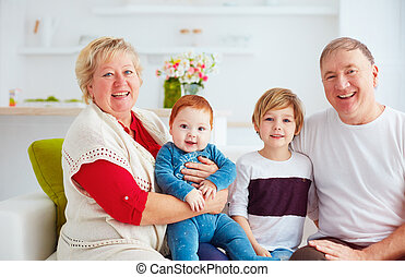 portrait of happy grandparents and grandchildren at home
