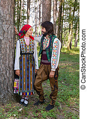 Bulgarian traditional costume - Romantic couple posing in a...