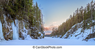 ice landscape - frozen river with ice and snow in a forest...