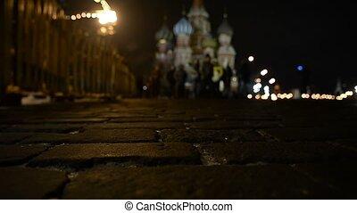 Defocused people go on a street