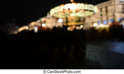 Blurred merry-go-round in Wonderland for background use -...