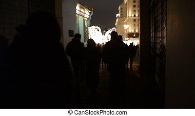 Defocused people go on a street - Defocused people go on a...