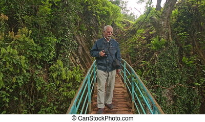 Man Stands on Small Wooden Bridge Photos Landscape of Park -...