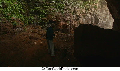 Old Man Walks in Dark Cave to Light Misty Exit by Waterfall...