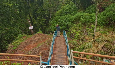 Man Stands on Small Wooden Bridge Photos Landscape of Park