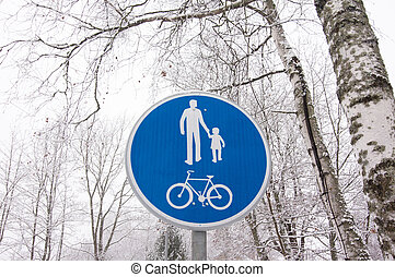 Bicycle and pedestrian lane road sign on pole post.